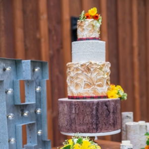 Gold And Ivory Three-Tiered Wedding Cake