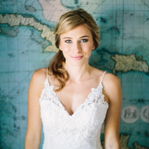 Beautiful bride in front of wall map