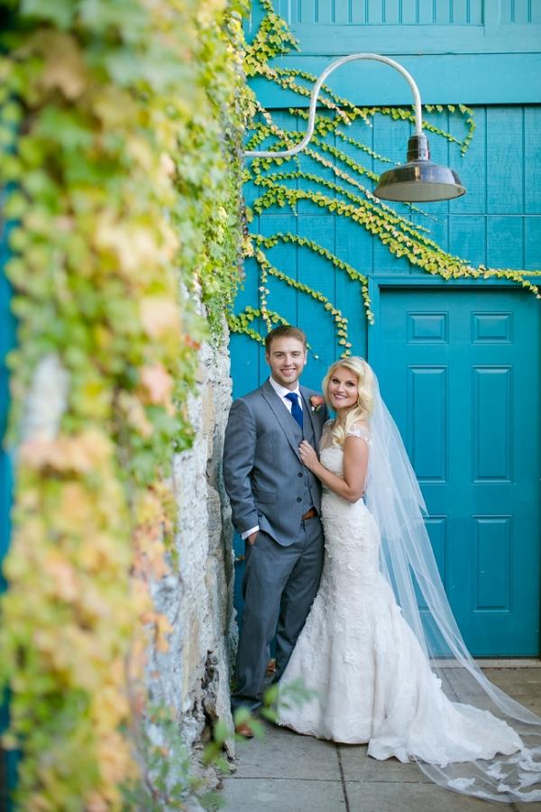 Beautiful Bride & Groom in Front of Turquoise Door