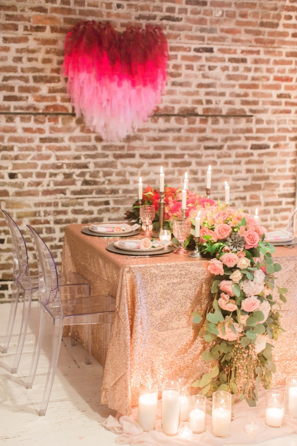 Romantic gold sequins table cloth, taper candles, and flower runner