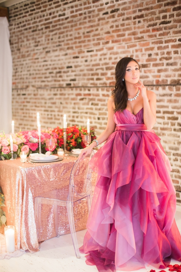 Bright pink and red ombre gown with gold romantic table