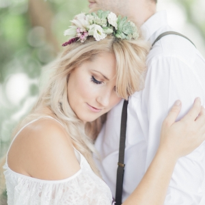 Bohemian bride and groom sweet embrace