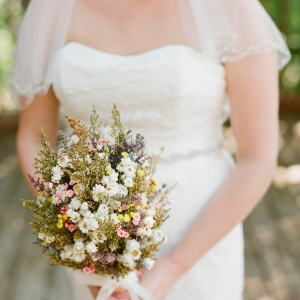 Bride holding dried flowers