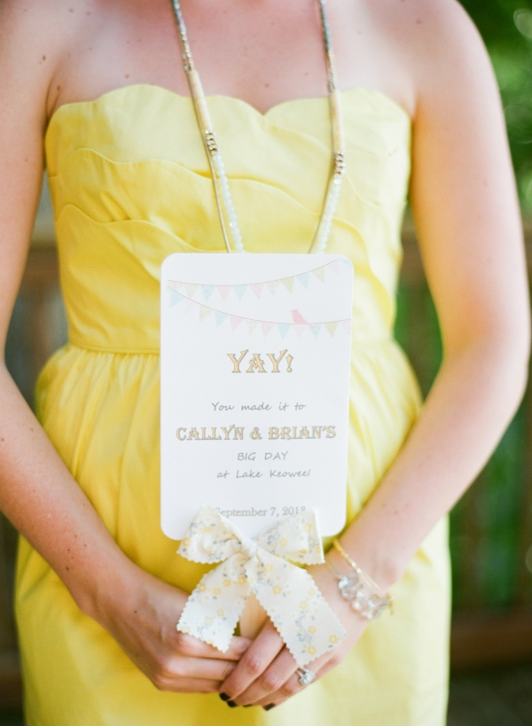 Pretty stationery and bridesmaid in yellow