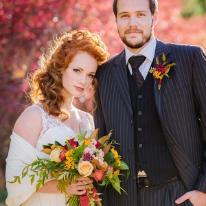 Bride And Groom Portrait With Fall Foliage