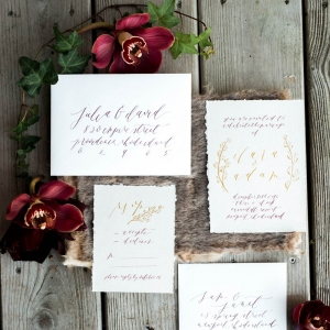 Merlot, gray, and gold invitation suite