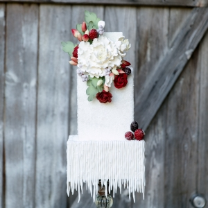 Modern red and white cake with icicle-like bottom