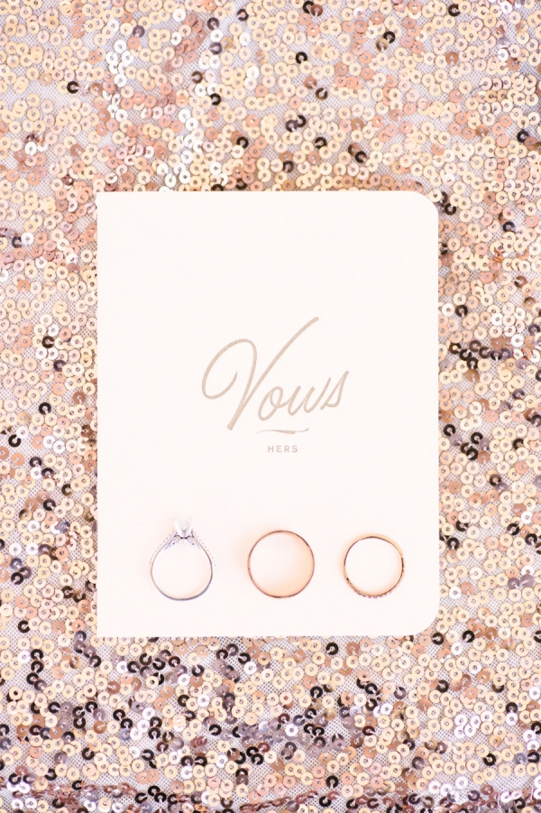 Vows and rings on rose gold sequins