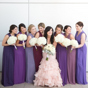 Bridesmaids in different shades of purple with bride in blush