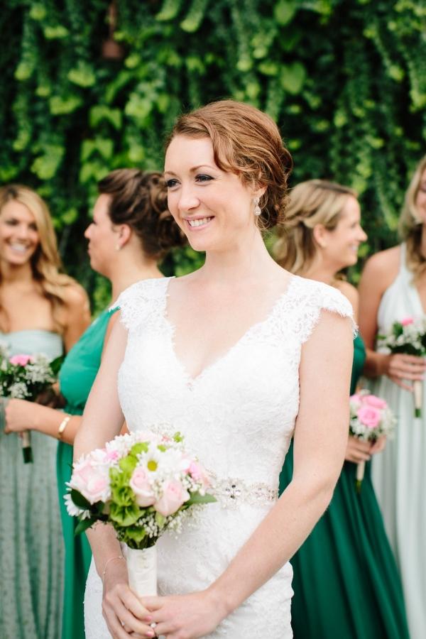 Bride with bridesmaids in green