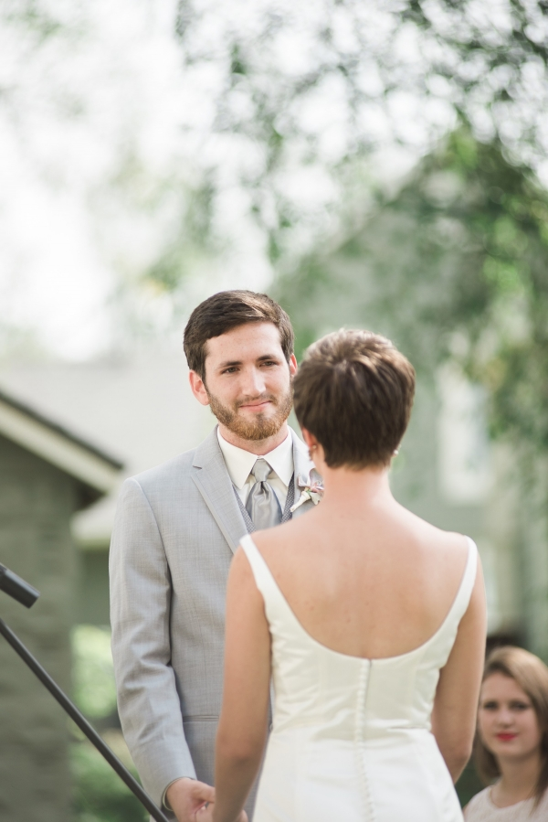 Groom in light gray suit and tie