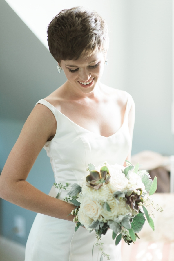 Romantic bride with white and green bouquet