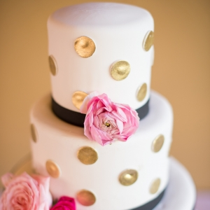 Black, white, and gold wedding cake
