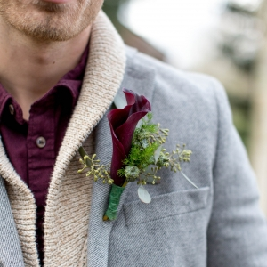 Groom in casual attire with calla lily boutonniere