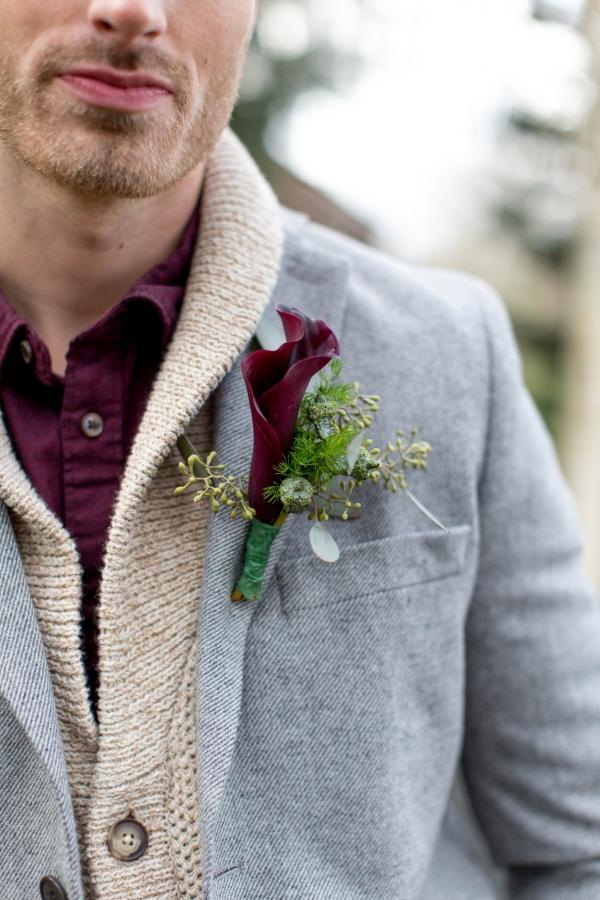 Groom in casual attire with calla lily boutonniere