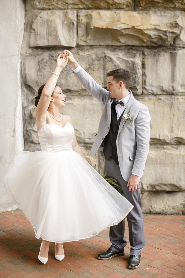 Groom Twirling Bride