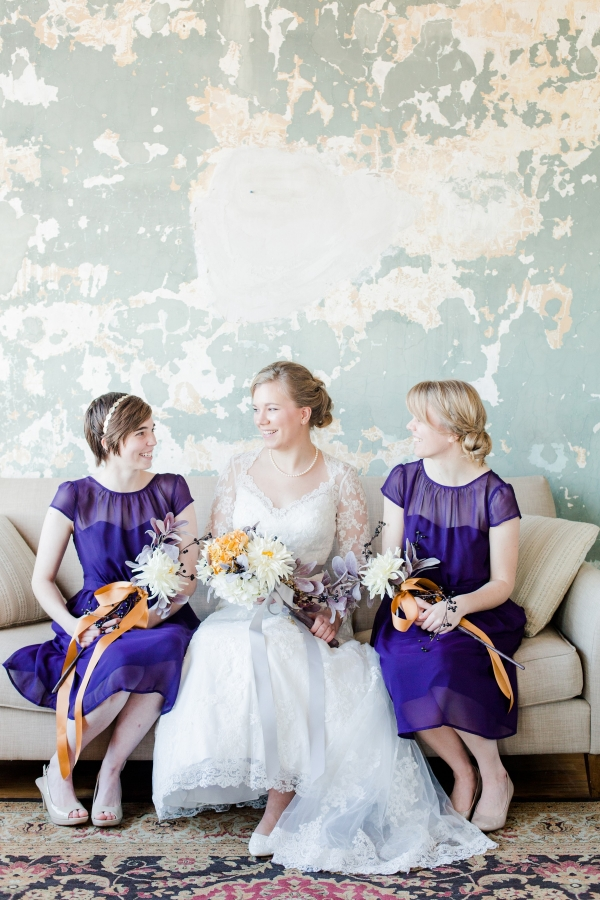 Bride with bridesmaids in pretty purple