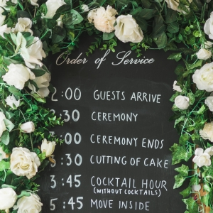 Chalkboard wedding schedule sign