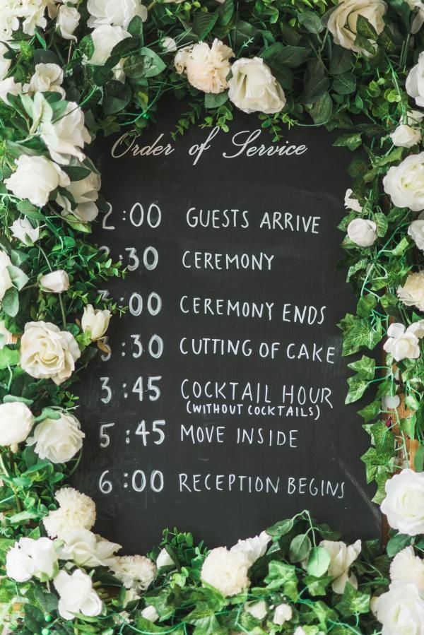 Chalkboard wedding schedule sign