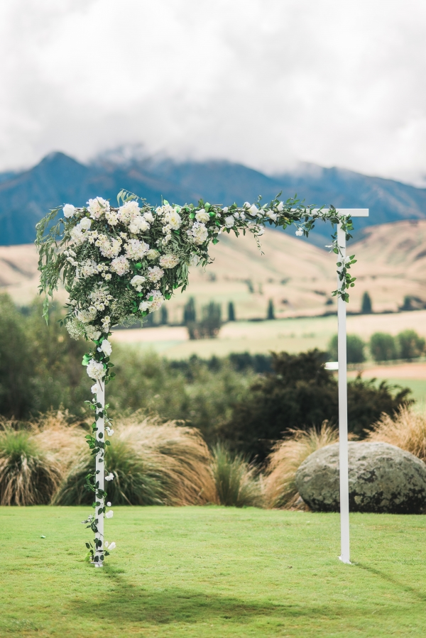 New Zealand ceremony arch with white and green flowers
