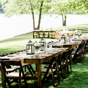 Wooden Lakeside Reception Tables With Lanterns