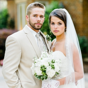 Gorgeous Bride And Groom With White And Green Bouquet Tied With Lace