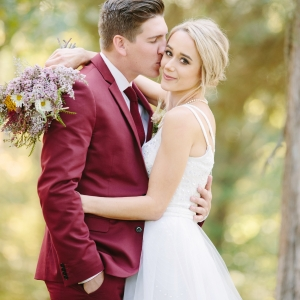 Groom In Burgundy Suit, Hops Boutonniere & Boho Bride