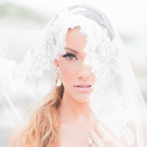 Dreamy Bride Under Lace Veil