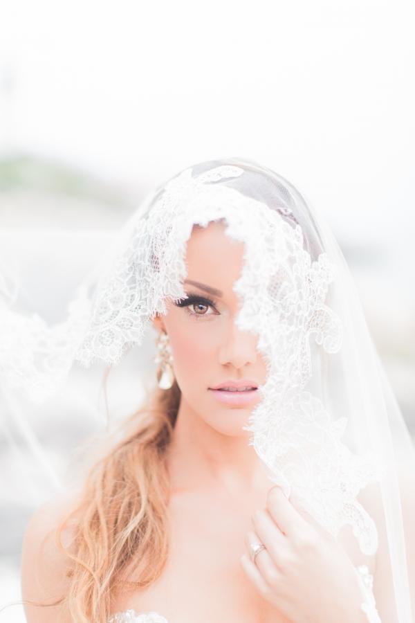 Dreamy Bride Under Lace Veil