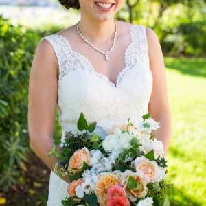 San Francisco bride with orange, peach, and ivory bouquet