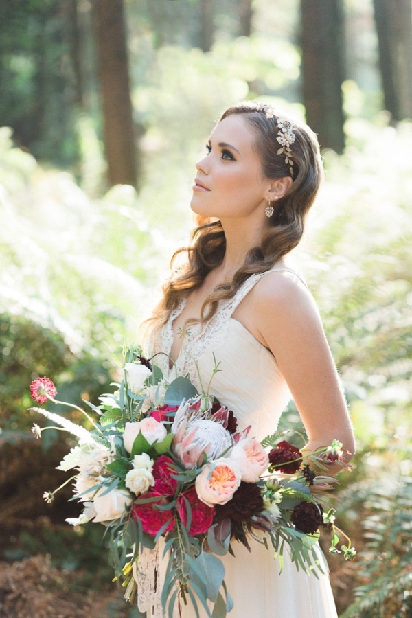 Ethereal bride in forest with unstructured bouquet