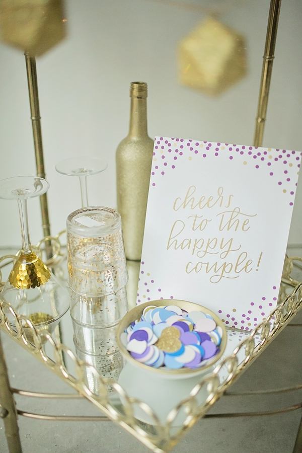 Gold, turquoise, and pink wedding details