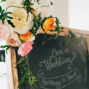 Wedding chalkboard sign with romantic flowers