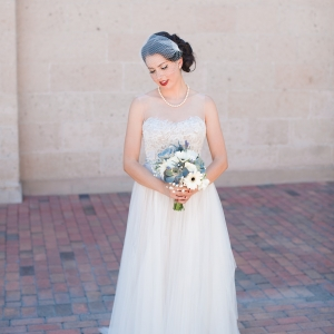 Bride in BHLDN Penelope gown with succulent, Gerber Daisy, rose and lavender bouquet
