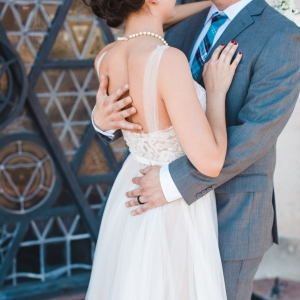 Bride in BHLDN Penelope gown and groom in gray suit
