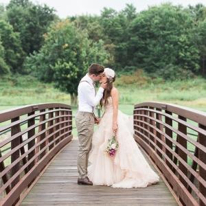 Bride in blush Watters WToo gown and groom in suspenders