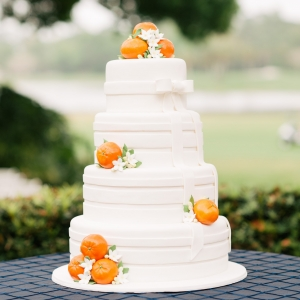 Orange, Navy Blue, and white citrus adorned wedding cake