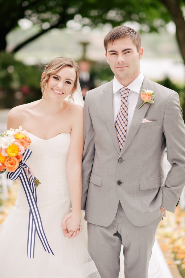 Bride and groom in orange and Navy Blue citrus wedding inspiration