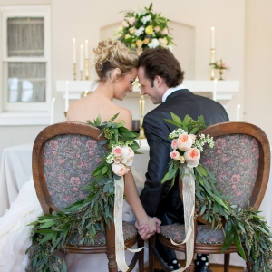 Elegant garland draped on vintage chairs