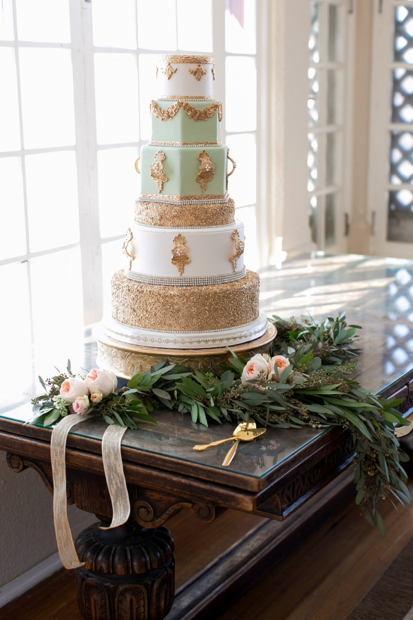 Gold, mint and ivory tiered wedding cake