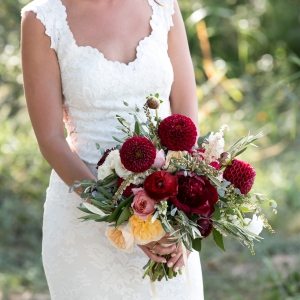 Wine colored dahlia, cream cabbage roses and pink peony bouquet