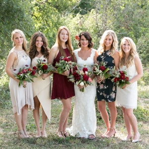 Bride with bridesmaids in wine, black, and white mismatched dresses