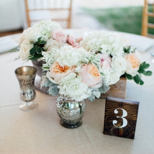 Blush and white centerpiece with wood table number