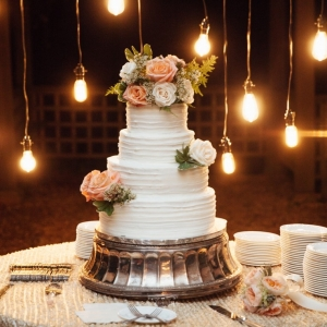 Cake table with hanging edison lights