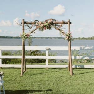 Rustic floral ceremony arch
