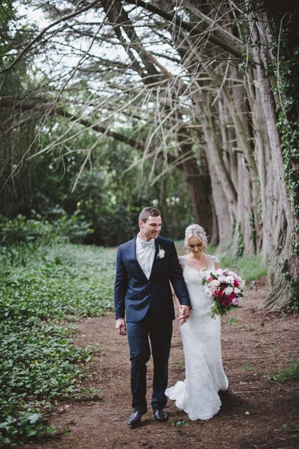 Newlyweds walking through forest together