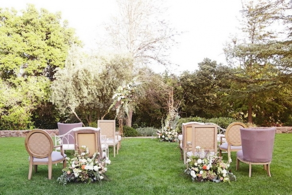 Mismatched Vintage Ceremony Seating with Floral Arch