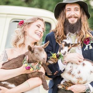Vintage farm wedding portrait with goats