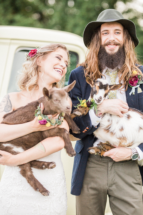 Vintage farm wedding portrait with goats