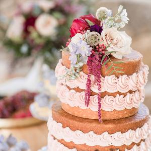 Naked wedding cake with swirled buttercream
